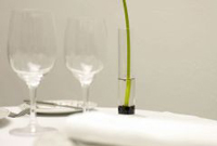 Wine glasses and white linens on table