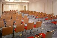 Meeting room with rows of chairs facing forward