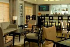 Tables, chairs and couches at New Town Lounge