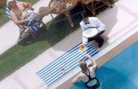 Person being served food on edge of pool