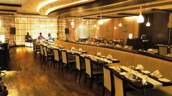 Tables and booths inside Punj Spice