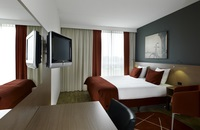 Hotel room with red and white decor