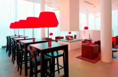 Bright red lamps and comfortable chairs in Executive Lounge