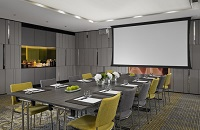Meeting room with long table and projector screen