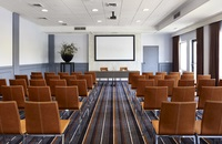 Rows of chairs facing projector screen