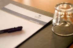 Notebook with pen and glass in Utrecht hotel business centre