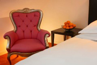 Plush red chair in Amsterdam hotel room