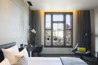 Hotel room in Amsterdam with cityscape views from window