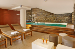 Hotel's active club with stone accents and lounge chairs