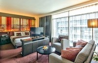 Suite with king bed and seating area