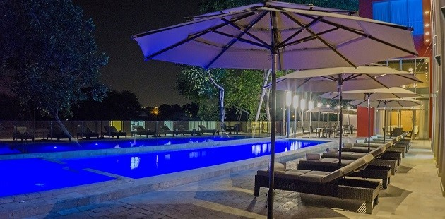 Sparkling outdoor pool with lounge chairs and umbrellas