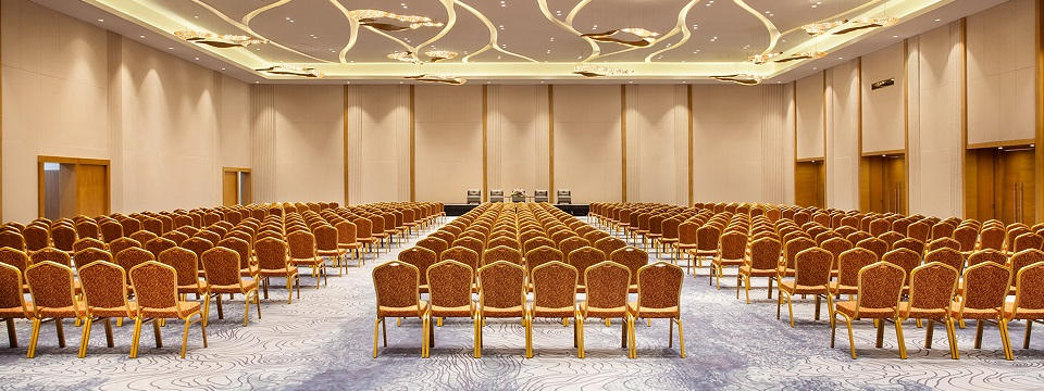 Spacious event room with stage and ample seating