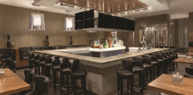 Bar area with TVs and seating