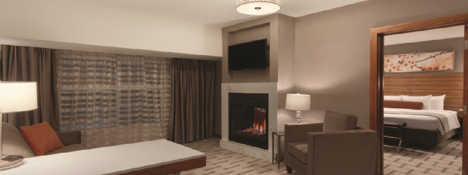 Suite with separate living room and fireplace