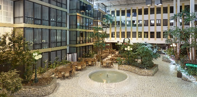 Hotel atrium with seating and access to restaurants