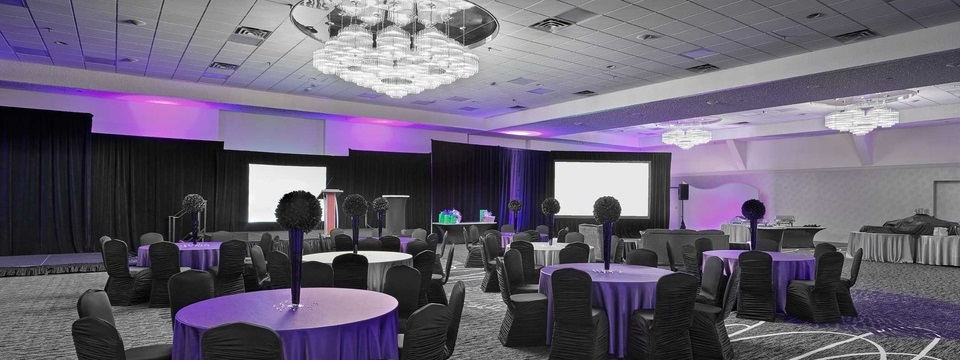 Event room with round tables and purple accents