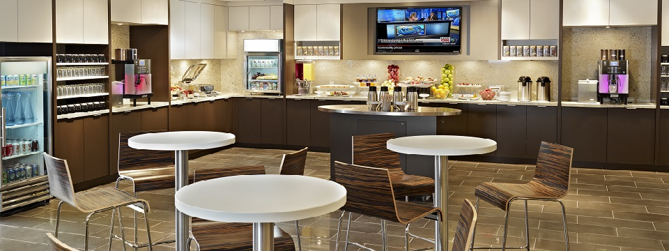Corporate Café with fresh fruit, drink selections and wall-mounted TV