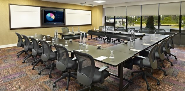 Meeting room with a U-shape arrangement and a flat-screen TV