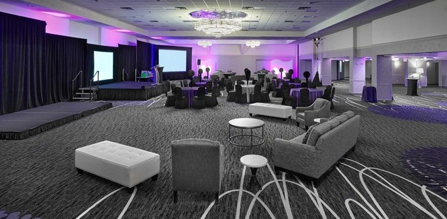 Jubilee Ballroom with a stage area and comfortable seating