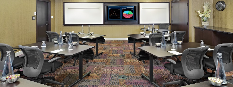 Meeting room with whiteboards and digital monitor