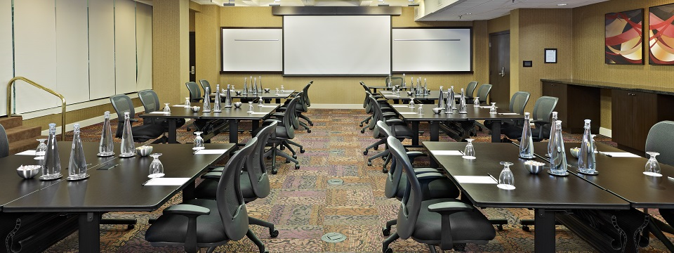 Meeting space with whiteboards and projection screen