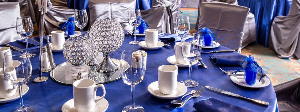 Wedding reception with blue decor and crystal accents