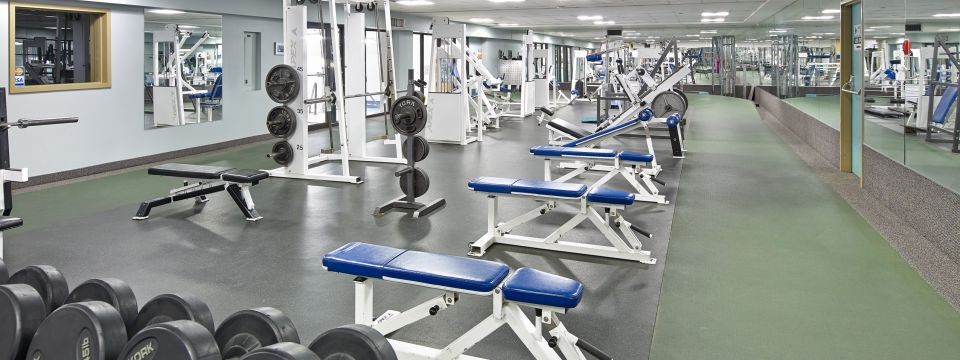 Edmonton hotel's gym with free weights and benches
