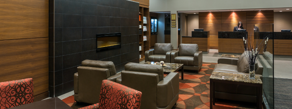 Lobby seating area with couch, chairs and table