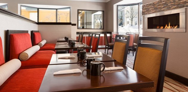 Restaurant tables with cushioned booths and chairs