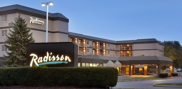 Exterior of Radisson Hotel Akron/Fairlawn lit up at dusk