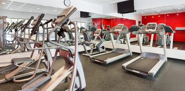 Fitness center with treadmills, ellipticals and a flat-screen TV