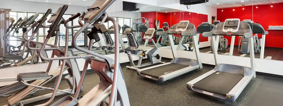 Hotel fitness center with treadmills, ellipticals and a flat-screen TV