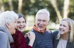Senior couple laughing with their granddaughters