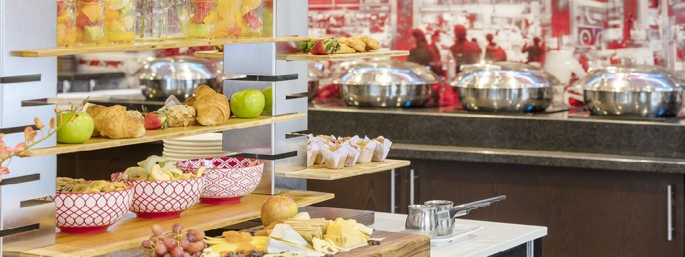 Breakfast buffet with fresh fruit, pastries, cooking stations and more