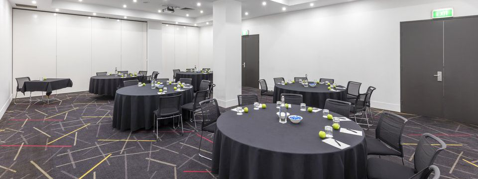 Meeting space with round tables in a cabaret style setup