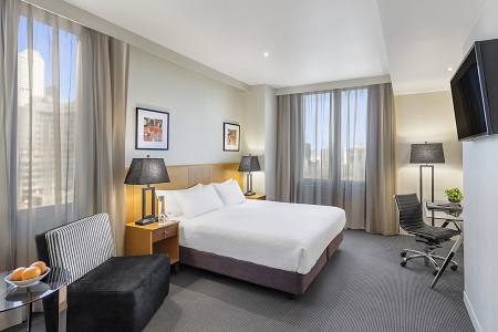 Premium Park View Room with a king bed, a flat-screen TV and a work desk