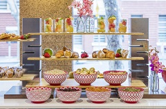 Breakfast display featuring fresh fruit, croissants and pastries