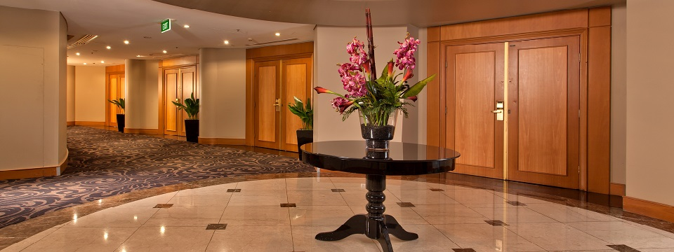 Pre-function area with floral arrangement on round table