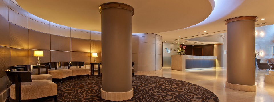Inviting hotel lobby featuring massive columns