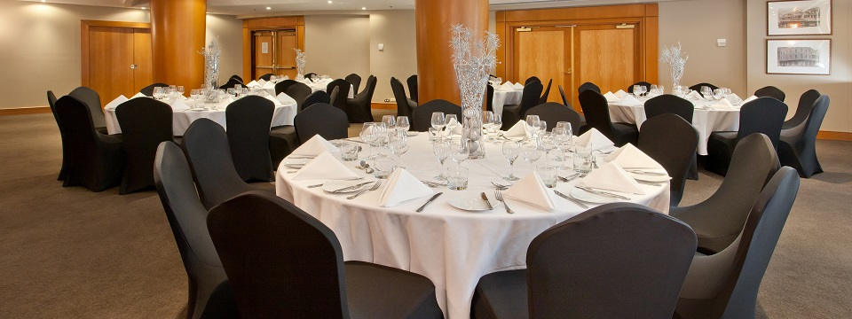 Round tables in banquet-style meeting setup