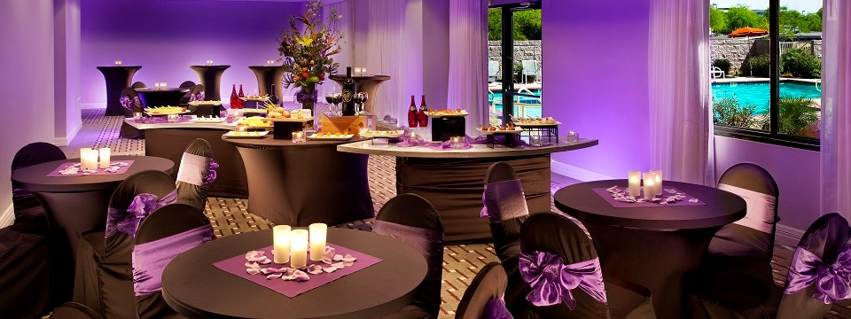 Hotel ballroom with black-and-purple decor