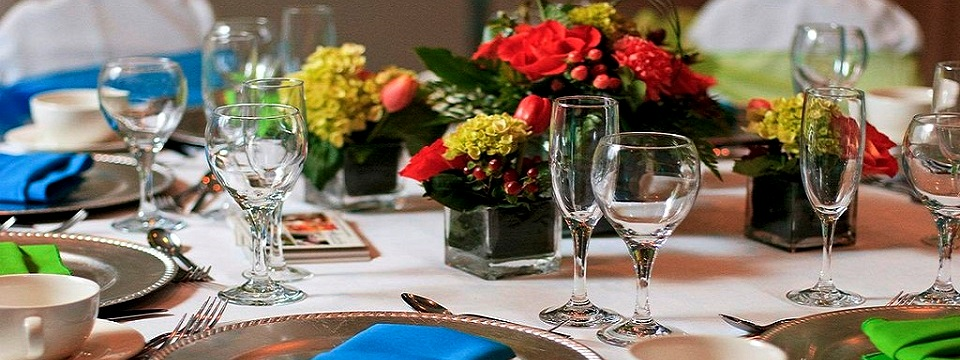 Place setting with glassware and floral arrangements