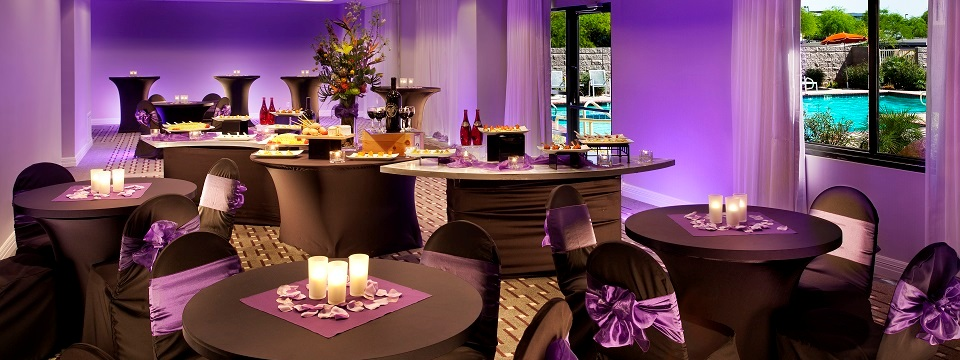 Ballroom with purple up-lighting and view of outdoor pool