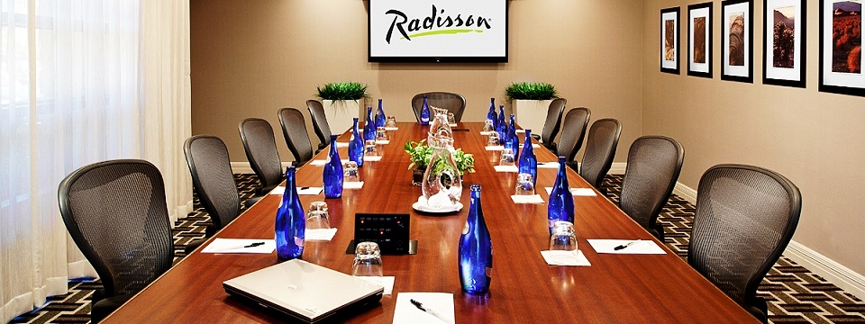 Meeting room with blue water bottles on boardroom table