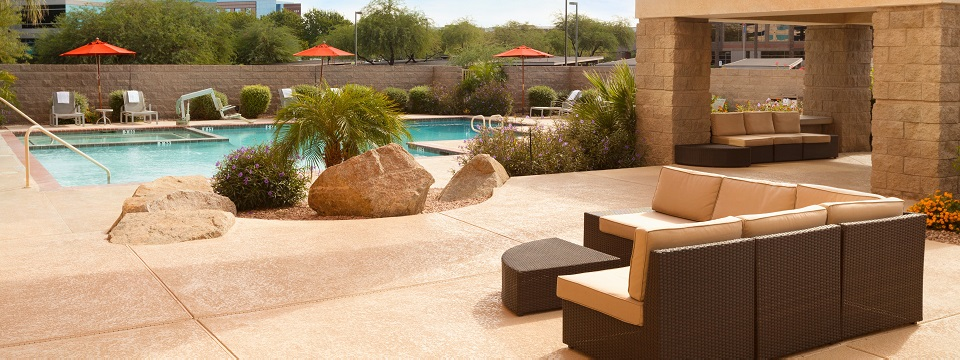 Outdoor pool and patio with Southwestern landscaping