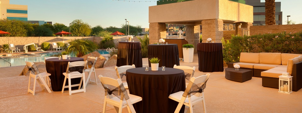 Cocktail party setup on outdoor pool patio