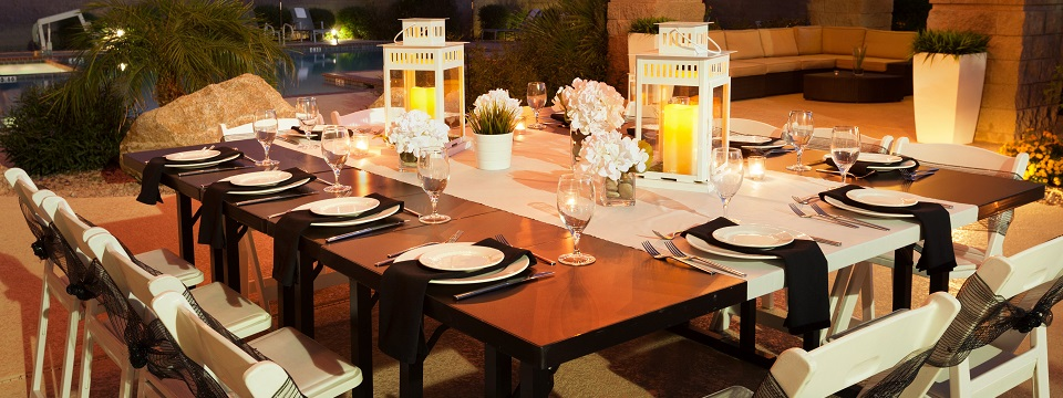 Candlelit, poolside dinner party setup at Phoenix hotel