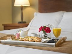 Breakfast platter with flowers, pastries and orange juice