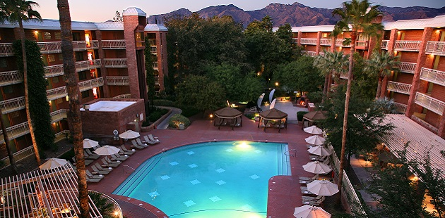 Sparkling Outdoor Pool With Deck Chairs Radisson Suites Tucson Exterior