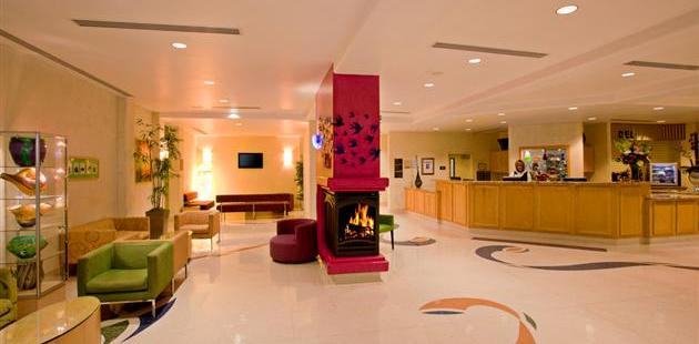 Lobby and front desk with colorful decor